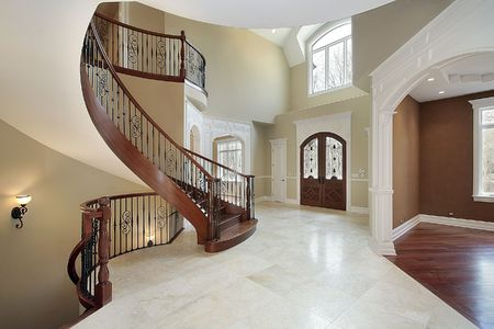 Foyer and staricase in suburban new construction home photo
