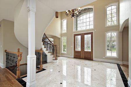 entryway: Foyer and circular staircase in new construction home
