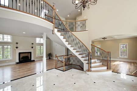 furnishing: Foyer with curved staircase in luxury home