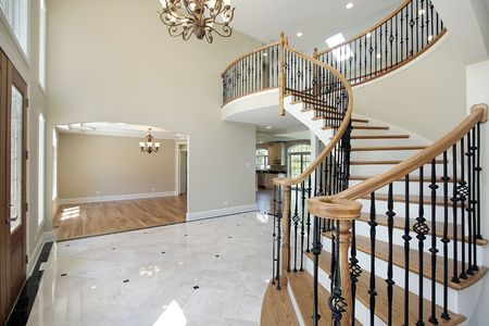Foyer in new construction home with view into dining room Stock Photo