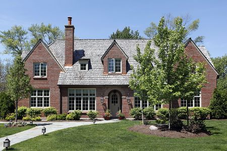 Front view of luxury home with cedar shake roof