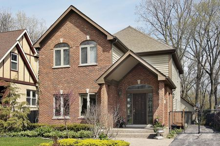 Front view of brick home in suburbs Stock Photo - 6761258