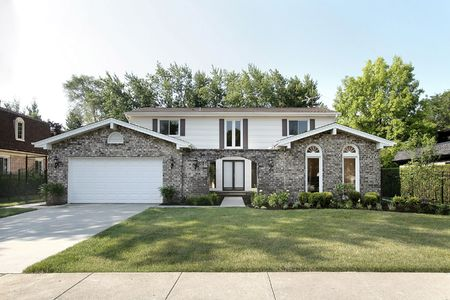 Brick home in suburbs with arched entry Stock Photo