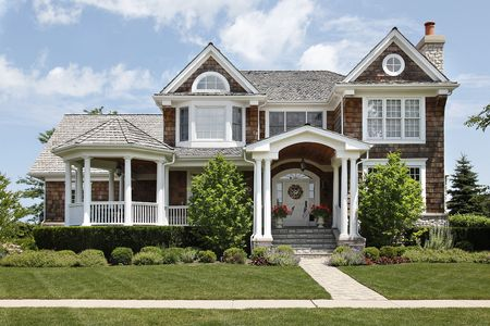Suburban home with columns and cedar roof photo