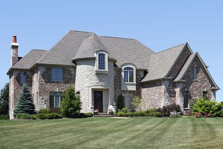 Luxury brick home in suburbs with stone turret Stock Photo - 6761067