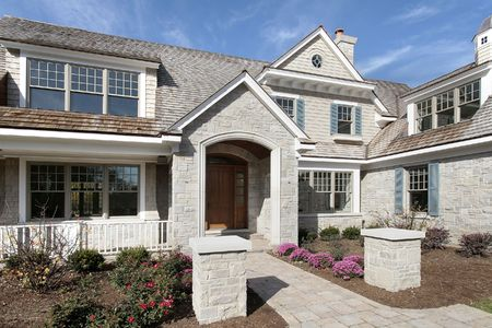 Entry way of new construction stone and cedar home Stock Photo - 6761263