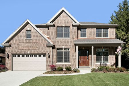 Brick home in suburbs with American flag photo