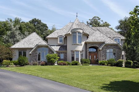 Luxury home in suburbs in with turret photo