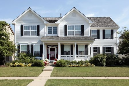front porch: White home in suburbs with front porch