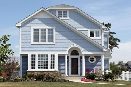 Blue house in suburbs with white columns
