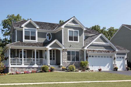 Suburban home with wraparound porch and columns photo