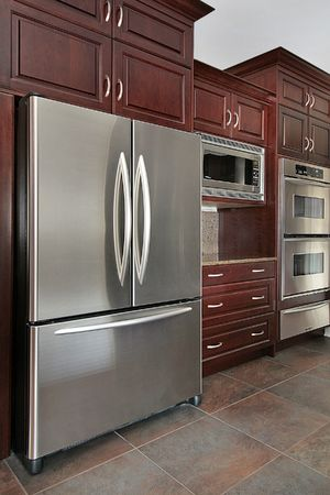 appliance: Close up of kitchen cabinets and refrigerator Stock Photo