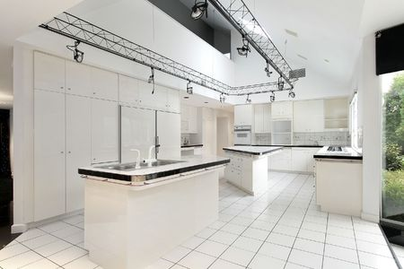 Modern white kitchen in luxury home with two islands Stock Photo - 6732820