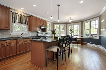 lighting: Kitchen in luxury home with marble island countertop Stock Photo