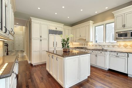 kitchen cabinets: Kitchen with marble island in new construction home