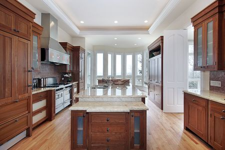 Kitchen with recessed ceiling and marble island Stock Photo