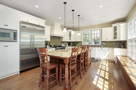 fixtures: Kitchen in luxury home with island and bench Stock Photo