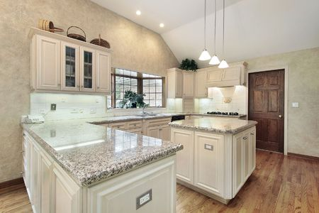 Kitchen in luxury home with oak cabinets photo