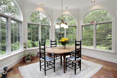 dining table and chairs: Eating area with large round picture windows Stock Photo