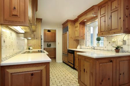 country kitchen: Country kitchen with wood cabinets and refrigerator