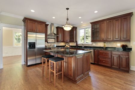 Kitchen in new construction home with wood and marble island Stock Photo - 6732672