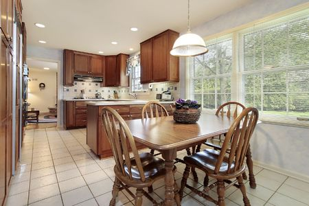 eating area: Kitchen with wood cabinetry and eating area