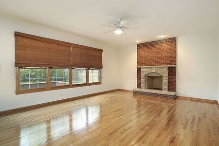 Living room with brick fireplace in vacant home photo
