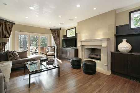 living room sofa: Living room in luxury home with large fireplace