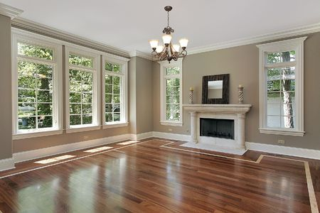 wood floor: Living room in new construction home with fireplace