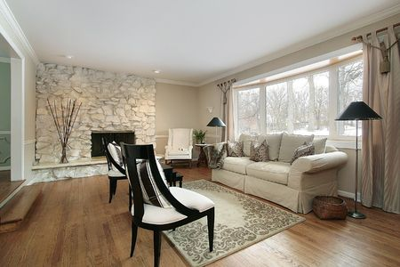living room interior: Living room in luxury home with stone fireplace Stock Photo