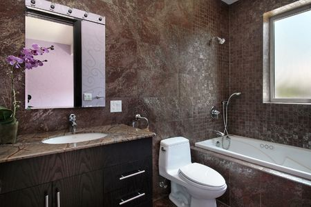 Powder room in luxury home with granite walls photo