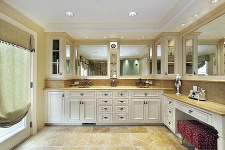 Master bath in yellow with stone flooring photo