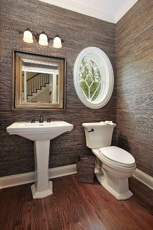 fixtures: Powder room in luxury home with circular window Stock Photo