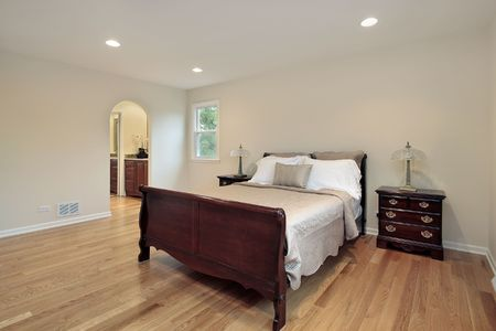 Master bedroom in suburban home with arched entry photo