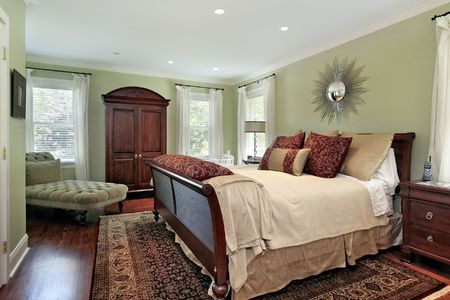 Master bedroom in suburban home with green walls