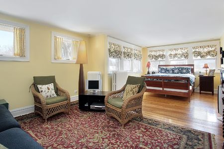 sitting area: Master bedroom in suburban home with sitting area