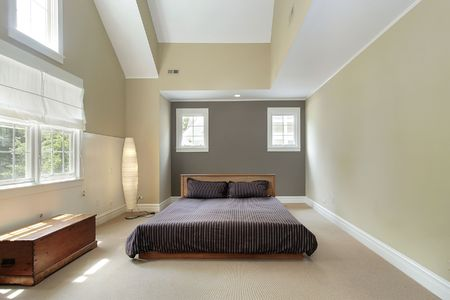 Master bedroom in comtemporary home with trey ceiling Stock Photo