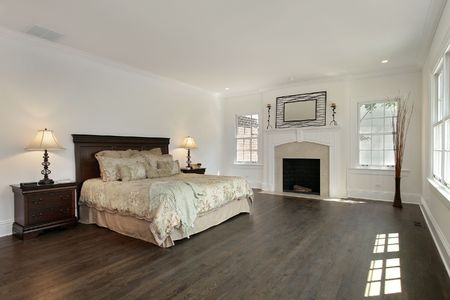Master bedroom in new construction home with fireplace photo