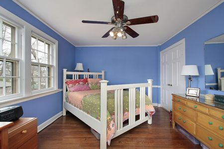 Bedroom in suburban home with blue walls
