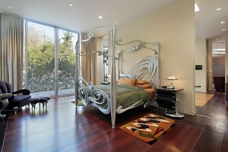 Master bedroom in luxury home with sliding doors to patio