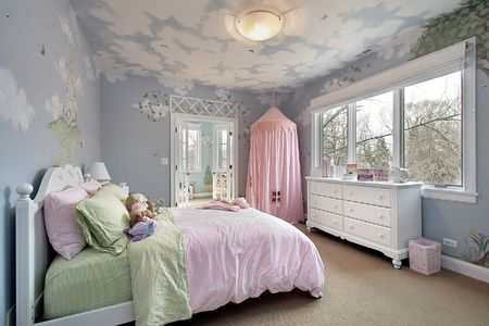Bedroom in suburban home with wall designs