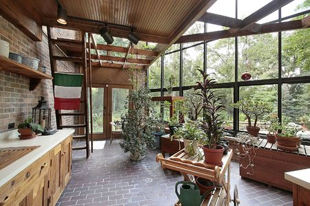 View Greenhouse: Greenhouse In Large Home With View To Patio Stock Photo