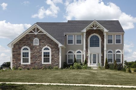 Home in suburbs with arch and stone garage Stock Photo - 6761224