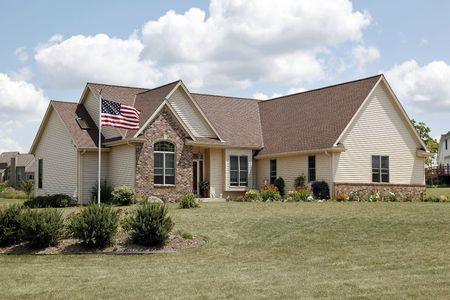Brick home in suburbs with American flag Stock Photo - 6761241