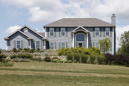 Suburban home with columns and blue siding Stock Photo - 6761243
