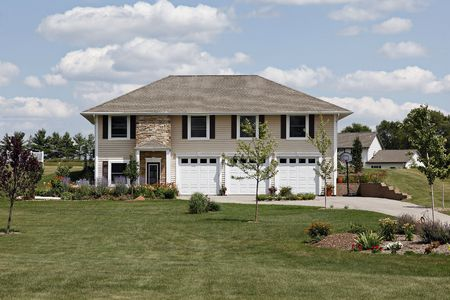 Home in suburbs with three car garage Stock Photo - 6761233