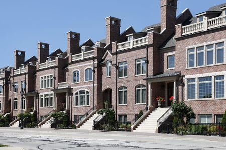 town homes: Three story brick town homes in suburbs