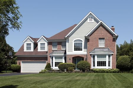 Front view of suburban home with arched entry Stock Photo - 6761253