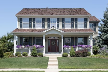front porch: Suburban home with blue shutters and front porch