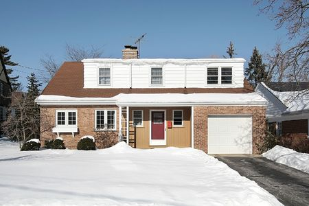 Red brick suburban home in winter with one car garage Stock Photo - 6761236